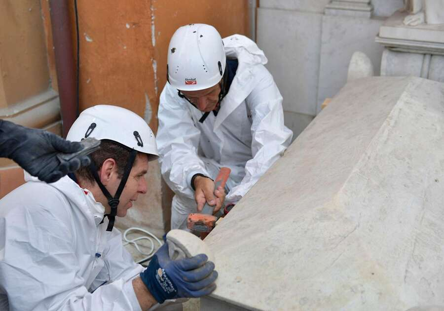 This photo taken and handout on July 11, 2019 by the Vatican Media shows forensics opening one of two tombs within the Vatican's grounds in the Teutonic Cemetery on July 11, 2019, as part of a probe into the case of Emanuela Orlandi, a teenager who disappeared in 1983 in one of Italy's darkest mysteries. - The Vatican is opening an internal probe into the case of Emanuela Orlandi, a teenager who disappeared in 1983 in one of Italy's darkest mysteries, and opened on July 11, 2019 two tombs within its grounds in the Teutonic Cemetery to see if it holds the girl's remains, after Orlandi's family's lawyer received an anonymous tip-off telling her to look inside the marble-topped grave. - LEHTIKUVA / AFP