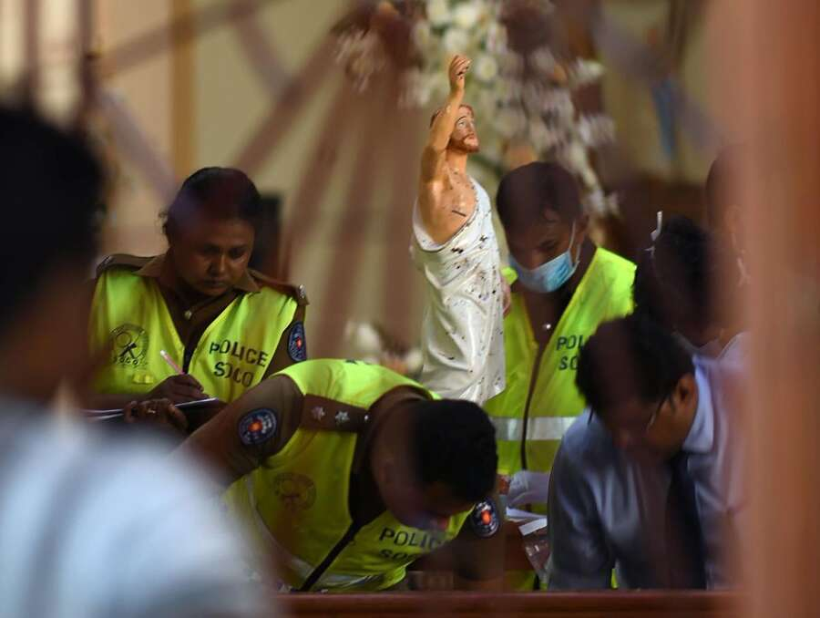 Security personnel inspect inside St. Sebastian's Church in Negombo on April 22, 2019, a day after the church was hit in series of bomb blasts targeting churches and luxury hotels in Sri Lanka. - The death toll from bomb blasts that ripped through churches and luxury hotels in Sri Lanka rose dramatically April 22 to 290 -- including dozens of foreigners -- as police announced new arrests over the country's worst attacks for more than a decade. LEHTIKUVA / AFP  Jewel Samad